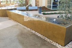 Bomanite smooth-troweled, integrally colored concrete was ideal to create this stunning water feature and the beautiful design is a perfect complement to the tranquil and therapeutic aesthetic outside of the Clovis Cancer Institute.