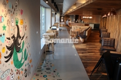 Bomanite Nickel Gray integrally colored Bomanite Modena SL was installed in this Starbucks by our colleague, Musselman & Hall Contractors, to create a custom polished decorative concrete overlay and a portion of this stunning flooring serves as a canvas for a colorful mural that is reflective of the unique character of this Kansas City community.