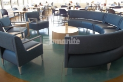 Upper Iowa University chose Concrete Arts to install the Bomanite Patene Teres Level Two Custom Polishing System with a custom blend of Bomanite Concrete Dyes including Warm Honey, Malt Brown, and accents of Turquoise to create a stained patina look that adds texture, warmth, and a beautiful elegance to the space.