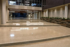 The Bomanite Renaissance Deep Grind polished concrete featured here contains a custom mix of individually sourced aggregates, sands, and added integral color that was ground and polished to produce a beautiful, solid surface that looks and wears very similar to terrazzo.