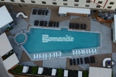 This site features approximately 10,000 square feet of pool deck design that Bomanite of Tulsa, Inc. installed utilizing the Bomanite Alloy Exposed Aggregate System and this decorative concrete hardscape is comprised of various geometric shapes and Bomanite Nickel Gray and Gobi Desert coloring to create contrast while accentuating the design aesthetic at the Tulsa Hard Rock Hotel & Casino.
