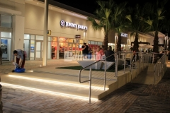 The beachy vibe of the Tanger Outlets Daytona was beautifully enhanced by adding Bomanite Alloy Exposed Aggregate decorative concrete with embedded seashells that add a unique reflective element to this step plaza and handicap ramp.