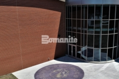 Bomanite Alloy was installed here with a beautiful blend of reflective aggregates, custom coloring, and personalized engraved elements to create a concrete paving surface that is highly durable and adds a unique decorative element to the outside of this school.
