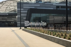 Bomanite Alloy decorative concrete was incorporated into the Bomanite Sandscape Texture walkways at LAFC Stadium and these contrasting bands with hints of glass aggregates and reflective mirror flakes serve as line formations that direct fans into the stadium while adding refined detail to the hardscape.