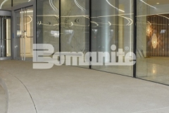 Earning the 2018 Silver Award for Best Bomanite Exposed Aggregate System, our associate Colorado Hardscapes utilized Bomanite Sandscape Refined to create the grand porte-cochere at 50 Fifty DTC, and their precise and technical installation resulted in distinctive detail that is a beautiful complement to the intricate and sophisticated design aesthetic at this office complex.