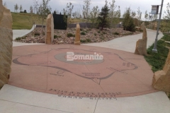 The hardscape surfaces throughout Centennial Center Park feature Bomanite Sandscape Texture decorative concrete, which was chosen to create an architectural concrete finish with consistent texture and durability, making it an ideal surface for the sandblasted graphics and text that display the informational content throughout the park.