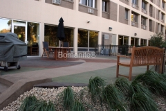 This distinctively beautiful hardscape installation was completed by Concrete Arts using Bomanite Sandscape Texture to provide a durable, decorative concrete surface with a vibrant pop of color that residents of Nan McKay Public Housing can enjoy.