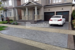 Our associate Bomanite Toronto utilized Bomanite Imprint Systems and the Bomacron Yorkshire Stone imprint pattern to create a stamped concrete driveway and front porch entrance for a Burlington, Ontario homeowner and their skillful installation and cohesive design earned them the Silver Award in 2017 for Best Bomanite Imprint Project under 12,000 SF.