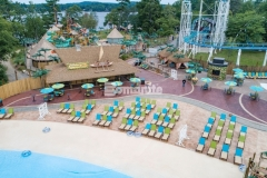 Bomanite Imprint Systems were used here by Harrington Bomanite to create 45,000 SF of stamped concrete and this hardscape features multiple patterns and colors that add a distinctive design aesthetic while providing a durable decking solution around the new water feature at Canobie Lake Park.