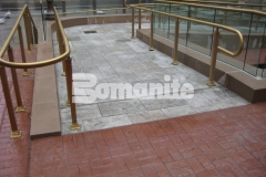 Bomanite Bomacron was installed here using the Medium Ashlar Slate pattern to create a pedestrian bridge and wheelchair access ramps and this durable, decorative concrete adds a beautiful design aesthetic throughout this pavilion.