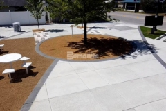 Bomanite Bomacron Sandstone Texture imprinted concrete was installed here as accent paving and was perfect to create definition in this exterior space and complement the surrounding hardscape surfaces and overall design aesthetic at Owasso's Redbud Festival Park.