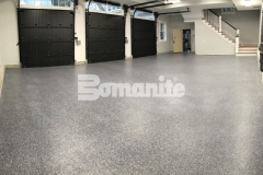 Our colleague, Premier Concrete Construction, installed Bomanite Broadcast Flake in this garage as a solution to a badly poured concrete foundation and the salt and pepper finish adds an architectural design element to the space while providing a protective flooring surface that will stand up to long term wear and tear.