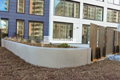 Featured here is a curved planter wall that was finished with Bomanite Micro-Top ST, a decorative concrete overlay that is entirely water-based making it extremely environmentally safe, while adding a beautiful, decorative finish that fits in perfectly with the urban design features at this mixed-use luxury condominium development.