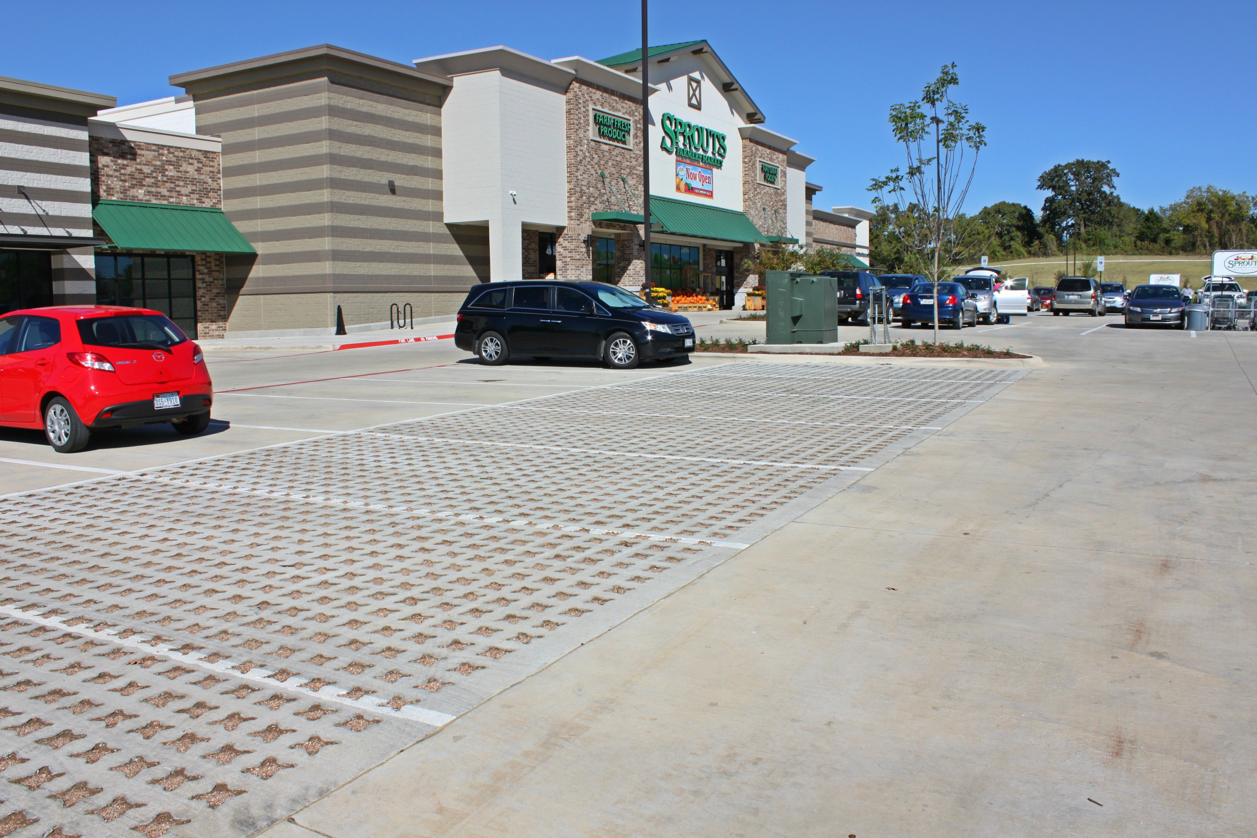 Grasscrete Stone Filled pervious concrete parking lot at Sprouts Farmers Market in Denton, Texas, was installed for low maintenance and to control storm water.