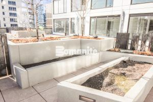 Terraced view of planters and seat walls using Bomanite Toppings Systems with Bomanite Micro-Top ST and Sandscape finishes at The Coloradan at Denver Union Station.