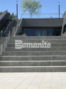 These Benches are Bomanite Sandscape Texture decorative concrete and the stairs to the left are plain gray concrete at Banc of Calif LAFC Stadium,