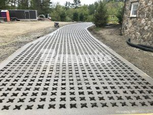 Long view of Bomanite Grasscrete Pervious Concrete Systems using Partially Concealed open voiids of an environmentally friendly project at an Essex county estate.