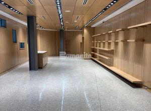 Room with shelves and beautiful Bomanite Custom Polished VitraFlor decorative concrete flooring at Dallas Holocaust and Human Rights Museum designed by Omniplan and installed by Texas Bomanite.