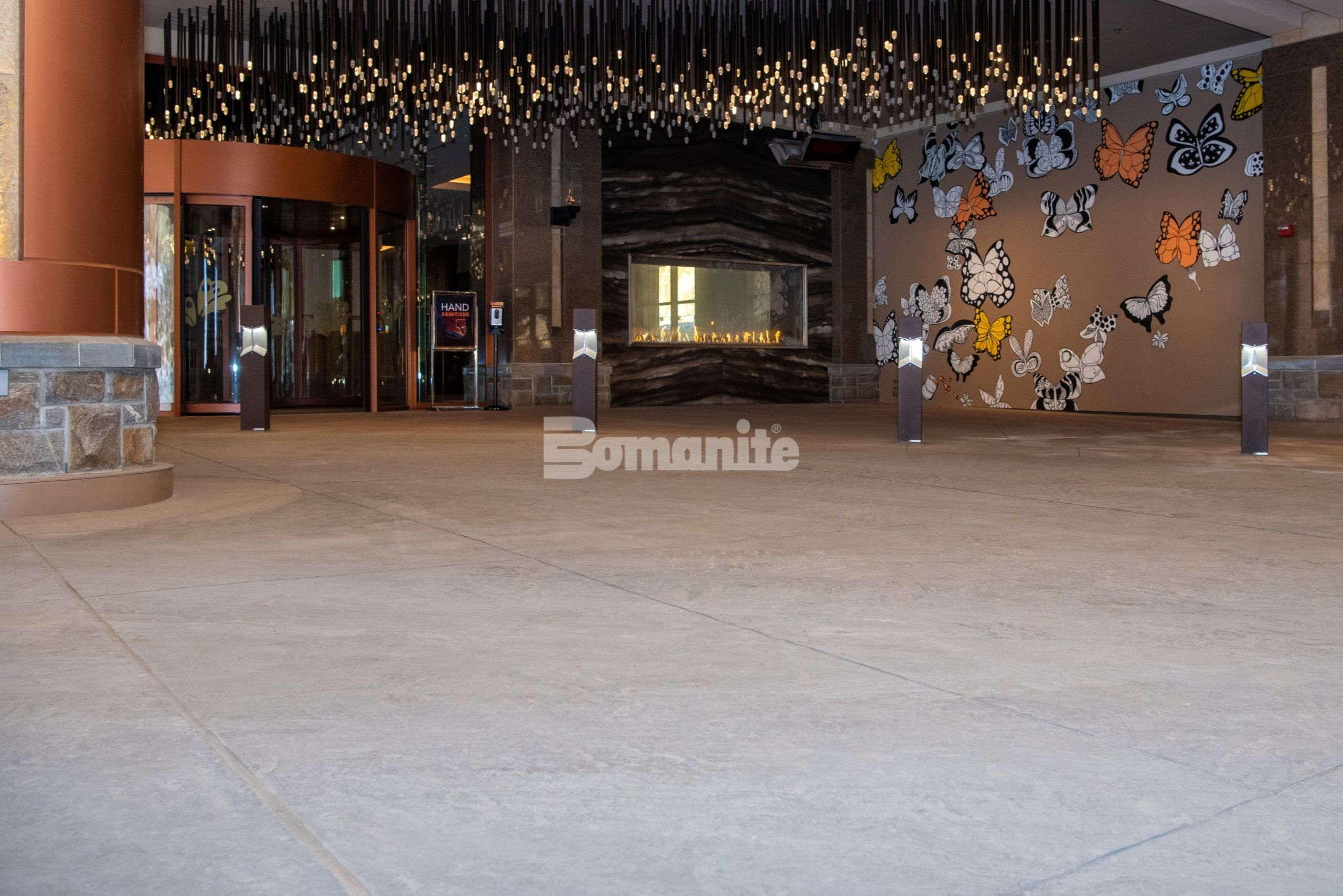 Monarch Casino Black Hawk Colorado Built a Luxury Port Cochere with Radiant Heat System installed under a Bomanite Decorative Imprinted Concrete Flooring in a Slate Texture with warm color tones provided by Bomanite Licensee Colorado Hardscapes.
