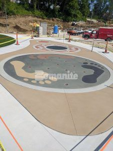 Overhead view of the splash pad using Bomanite Sandscape Texture Exposed Aggregate System with Bomanite Con-Color at the Community Park in Jefferson City, MO, installed by Bomanite Licensee Musselman & Hall Contractors, LLC.