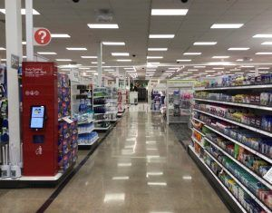 Long view down an aisle at Target East Lake in Minneapolis, MN, decorative concrete flooring using Bomanite Custom Polishing Systems with Bomanite Patene Teres installed by Bomanite Licensee Concrete Arts.
